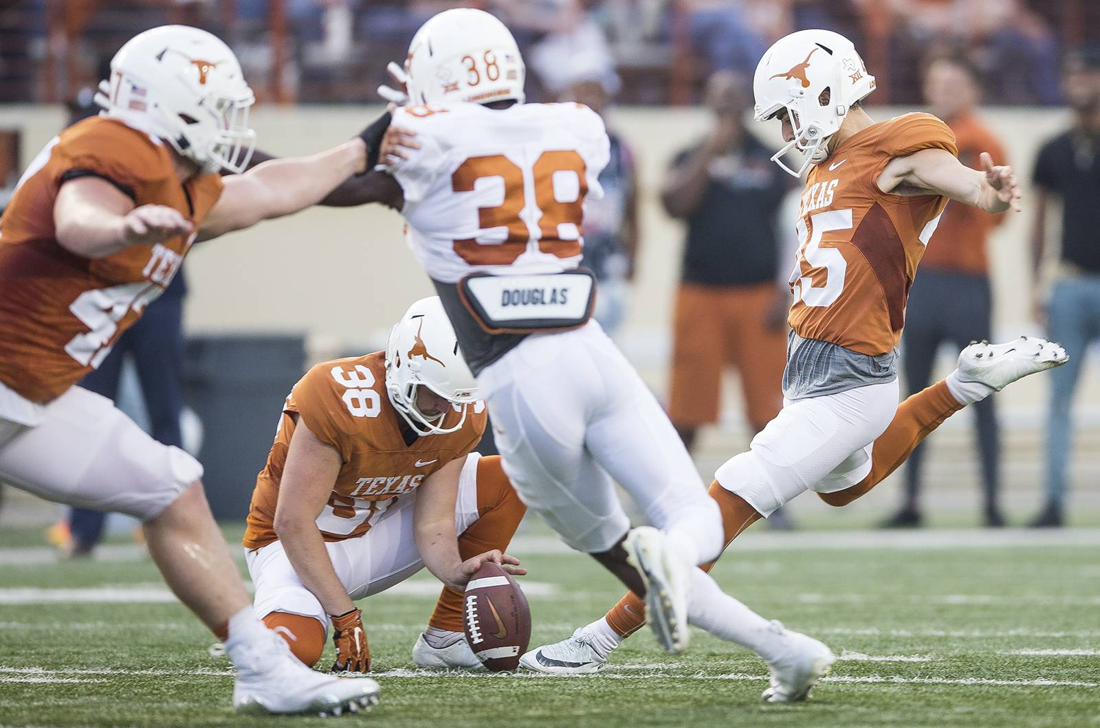 54983a0fd47 New football uniforms boast bigger  TEXAS  -- but is that orange getting  less burnt