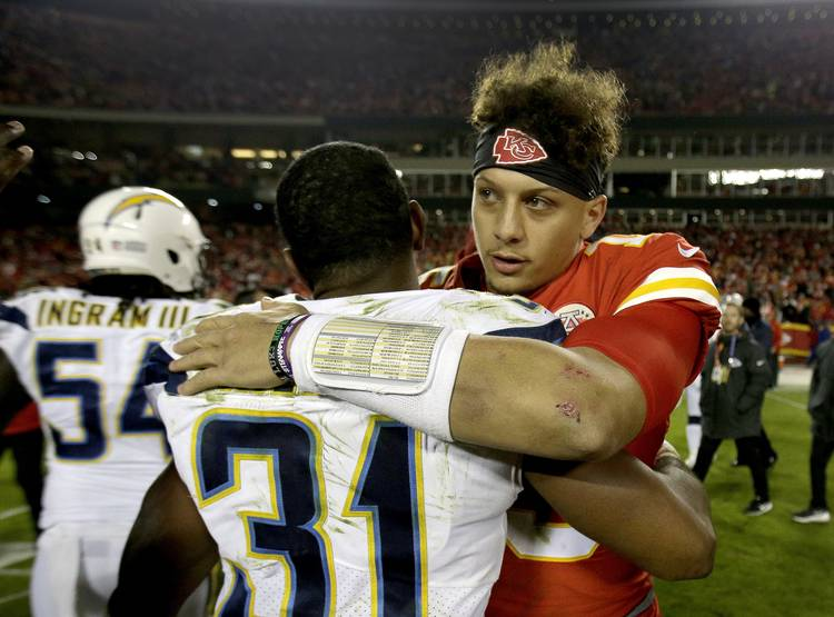 fde1fa9df926 Kansas City Chiefs quarterback Patrick Mahomes (15) and Los Angeles  Chargers defensive back Adrian Phillips (31) greet each other after an NFL  football game ...