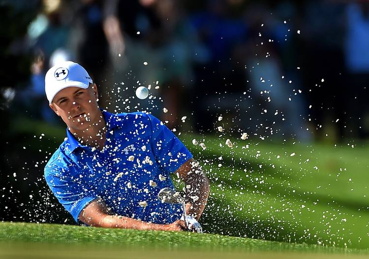 636ca14c60 Jordan Spieth hits a shot from a sand trap along the 10th green during the  final round of the Masters on Sunday, April 10, 2016, at Augusta National  Golf ...