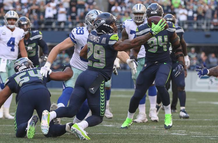 2dd63345c23b Free safety Earl Thomas  29 of the Seattle Seahawks intercepts a pass  against tight end Blake Jarwin  89 of the Dallas Cowboys in the fourth  quarter at ...